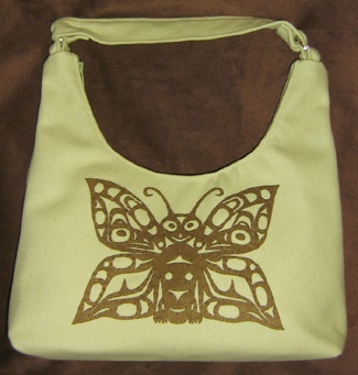 Haida Butterfly, Raven, Hawk on Green Fabric HandBag. $225.00