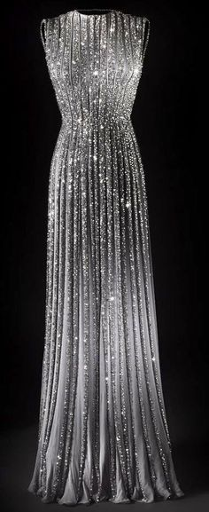 Love this gorgeous sparkling silver gown, has an aura of old Hollywood, circa 1940's
