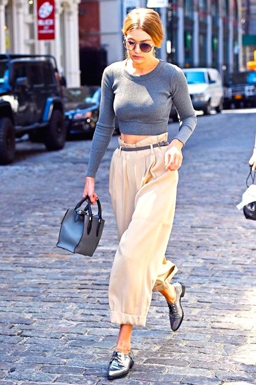 With its cinched in waist and flowing leg, the paperbag pant shape isn't the easiest trend to style but, our favorite model gives us an idea on how to work with it. A-lister Gigi Hadid went boyish-cool with a simple crop top, mini tote bag, skinny belt and menswear inspired flats.
