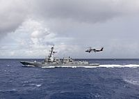 160628-N-SU278-035 SOUTH CHINA SEA (June 28, 2016) A MH-60R helicopter assigned to Helicopter Maritime Strike Squadron (HSM) 49 flies near the guided-missile destroyer USS Momsen (DDG 92). Momsen, along with the guided-missile destroyers USS Spruance (DDG 111) and USS Decatur (DDG 73), are deployed in support of maritime security and stability in the Indo-Asia-Pacific as part of a U.S. 3rd Fleet Pacific Surface Action Group (PAC SAG) under CDS 31. (U.S. Navy photo by Mass Communication…
