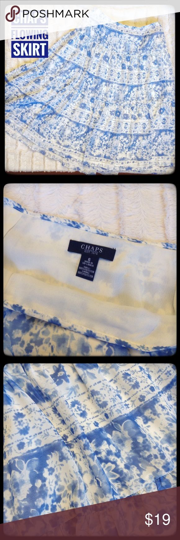 ✨Chaps Lined Flowing Blue and White Skirt Sz 6✨ Beautiful skirt by Chaps. Fully Lined, soft and Flowing A line design, this is a classic beauty. The length is rests right above the knee. The blue is a soft muted blend of royal and variances of blue. In excellent condition and ready to enjoy! Chaps Skirts A-Line or Full