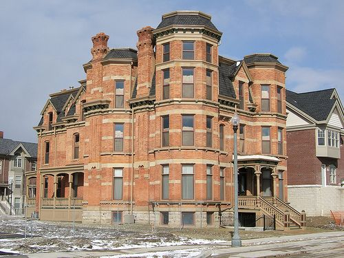 Detroit's abandoned mansions.    Unfortunately there are MANY of these places in Detroit...old, abandoned, sad. Can you picture this as a home????