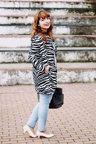 """Drawing Dreaming: """"Zebra"""" > Outfit - Zebra print coat; grey sweater; green statement necklace; light blue jeans; white low heels"""