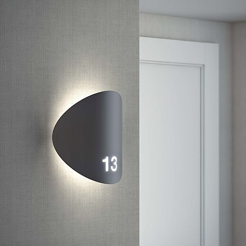Outdoor wall sconce providing direct and indirect light.Acrylic shade with a curved metal decorative front plate.Suitable for outdoor locations. Optional laser cut / serigraphy signage.Lamps: LED 8.5W (3000 oK / Ang. 120o...