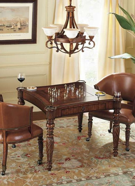 Sit down to a challenging game of chess with a friend at the handsome Mandalay Game Table with Chairs that boasts a solid mahogany frame embellished with tropically inspired carvings.