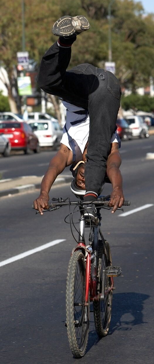 A man does crazy stunts on a bicycle at the Cape Argus Pick n Pay Cycle Tour