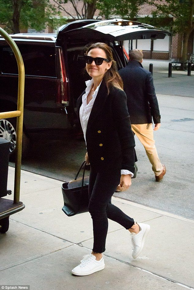 Casual-chic:She then gave her look a more casual vibe by adding distressed skinny jeans, which hugged her enviably slender legs, and a pair of white sporty Adidas trainers
