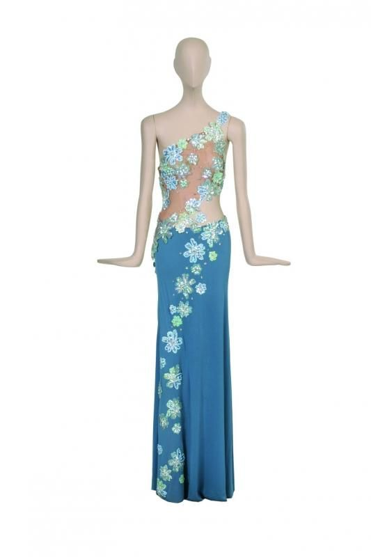 """BOB MACKIE FLOWER APPLIQUE ENSEMBLE Worn on a 1977 episode of """"The Sonny & Cher Show"""" during Cher's performance of the opening song """"Swearin To God."""" Blue jersey skirt with nude souffle diagonal crop top with light blue flower applique"""