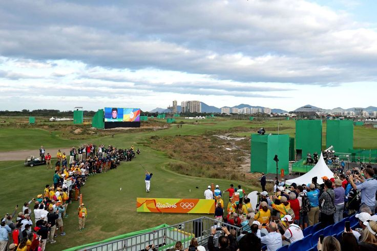 An overall view of the first tee as Adilson Da Silva of Brazil hits his tee shot hits his tee shot during the first round of men's golf in the Rio 2016 Summer Olympic Games at Olympic Golf Course.  -  Best images from Aug. 11 at the Rio Olympics