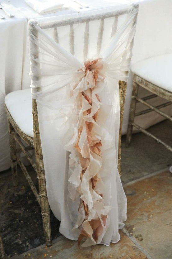 Romantic Wedding Chair Ruffles ~ whimsical sheer fabric creation makes for a beautiful cover over a plain white fold-up wedding chair.