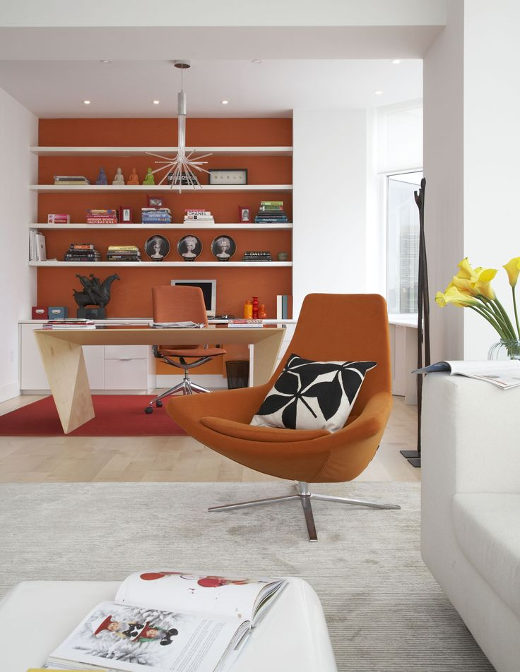 Living room | Orange shelves | Orange armchair | Bright | Colour pop