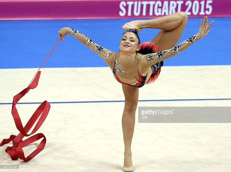 Germany's Jana Berezko-Marggrander performs with the ribbon in the individual all-around finals at the World Rhythmic Gymnastics Championships in Stuttgart, southwestern Germany, on September 11, 2015. AFP PHOTO / THOMAS KIENZLE