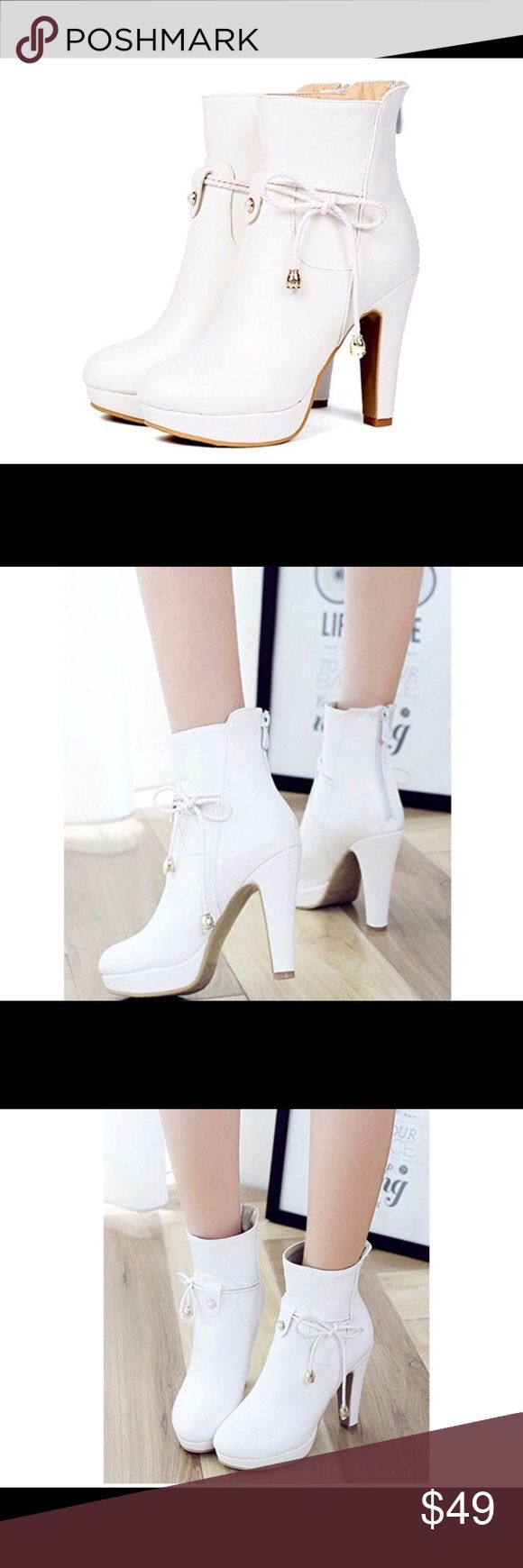 """White boots / Very cute white ankle booties 4"""" heel w/ 1"""" platform  Zipper in the back/ strings w/silver accents  New in the box 📦  Size 6.5.  Man made material/ faux leather.  Made in China.            Super cute/ too small for me Aisun Shoes Ankle Boots & Booties"""