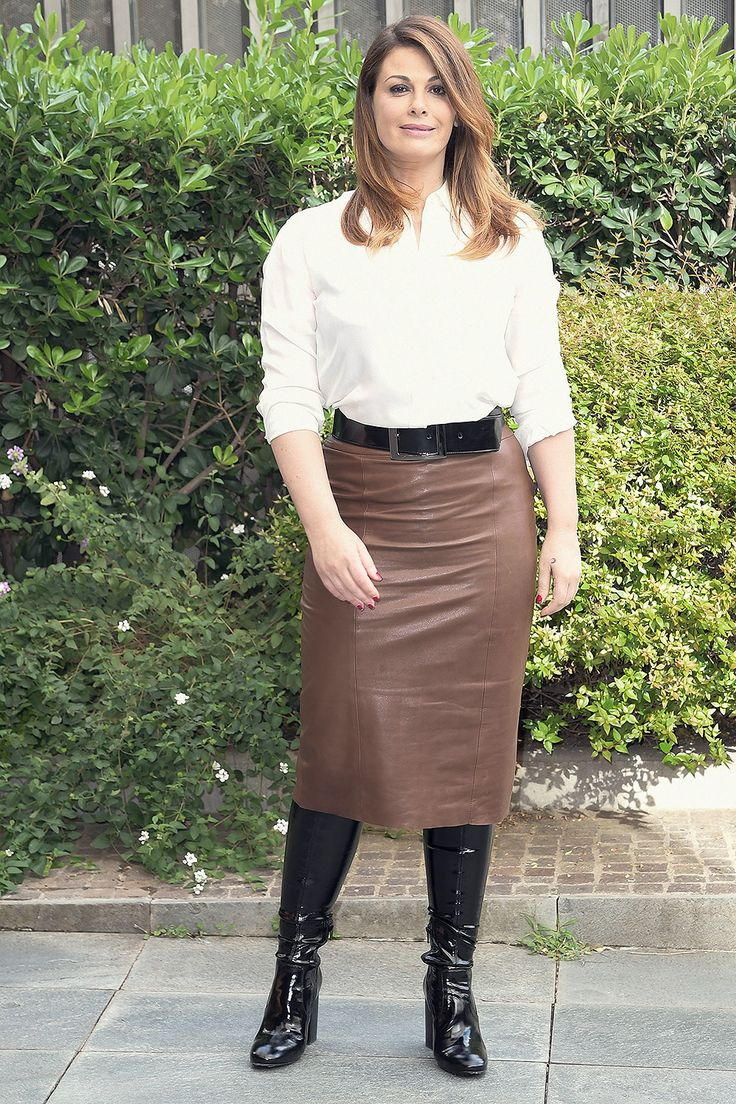 Vanessa Incontrada attends Scomparsa photocall in belted brown leather midi skirt and black patent leather boots