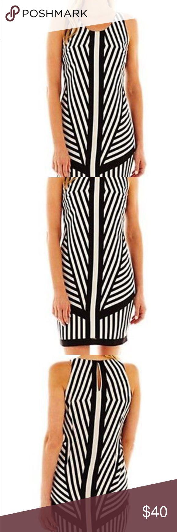 "J. Taylor Graphic Black & White Stripe Dress Stunning shift dress. Bold placed stripes to enhance your curves. Keyhole back closure, fully lined, darts at bust line and back.   100% poly  machine washable  36"" bust 34"" waist 40"" hips 37"" overall length Dresses"