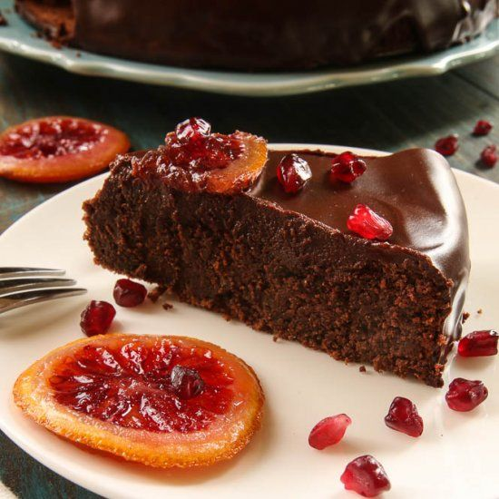 Buckwheat Chocolate Cake with Candied Orange slices is very decadent, rich and gluten-free. Very easy to make!