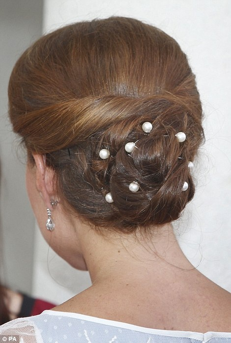 Kate wore her hair in the same glamorous up-do from earlier in the day but made it extra special with a few pretty pearl pins