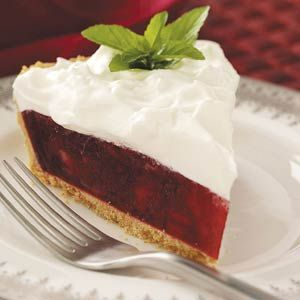 Cran-Raspberry Holiday Pie Recipe -Sweet raspberry gelatin tames the tartness of cranberries and pineapple in this holiday pie from Eddie Stott of Mt. Juliet, Tennessee. The fluffy marshmallow-flavored topping is simply amazing! Plan on having seconds.