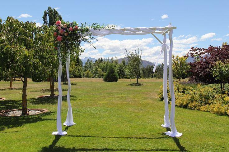 White framed archway with flowers http://www.wanakaweddingflowers.co.nz