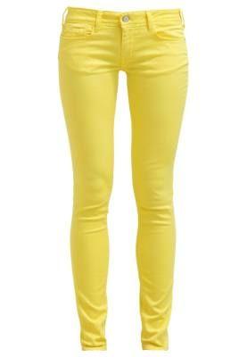 Vaqueros amarillos mujer