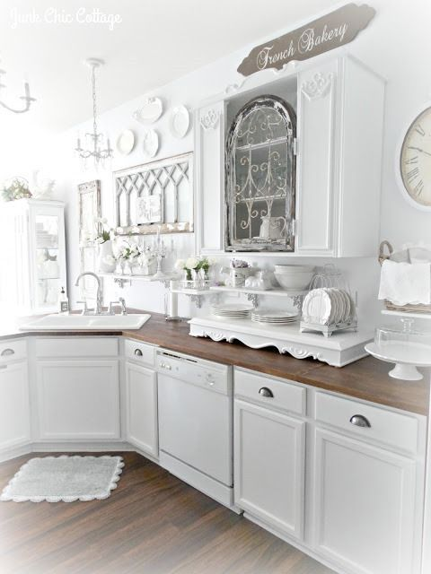 Shabby Chic Decorating - beautiful home - kitchen cabinetry and furnishings all painted white + lits of salvaged architectural treasures used to add character to your home - Shabbilicious Sunday visits Junk Chic Cottage