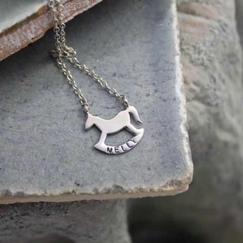 "This is a beautiful silhouette of a child's rockinghorse that we have designed in conjunction with the wonderful Rockinghorse Children's Charity. The charity are very close to many parent's hearts and this necklace enables you to have your child's name personalised on the bottom, producing a unique piece of jewellery completely bespoke to you, that can be treasured for years to come. The necklace comes with an 18"" chain as standard and you can make this necklace extra special by having the…"