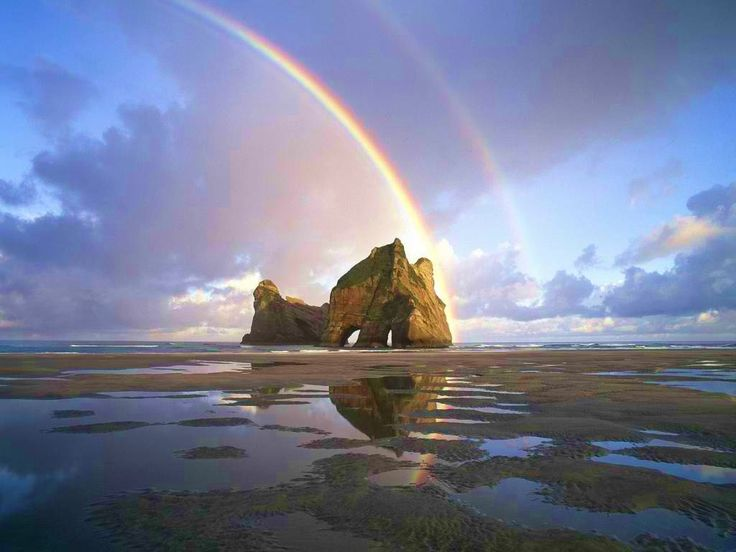 Where can you find free photographs of rainbows?