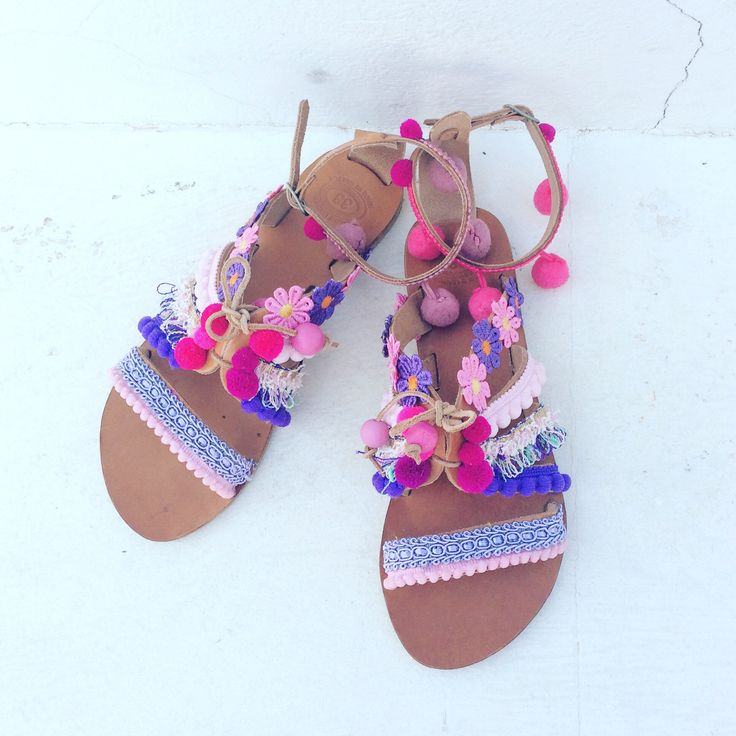A personal favorite from my Etsy shop https://www.etsy.com/listing/535060065/pom-pom-sandals-boho-greek
