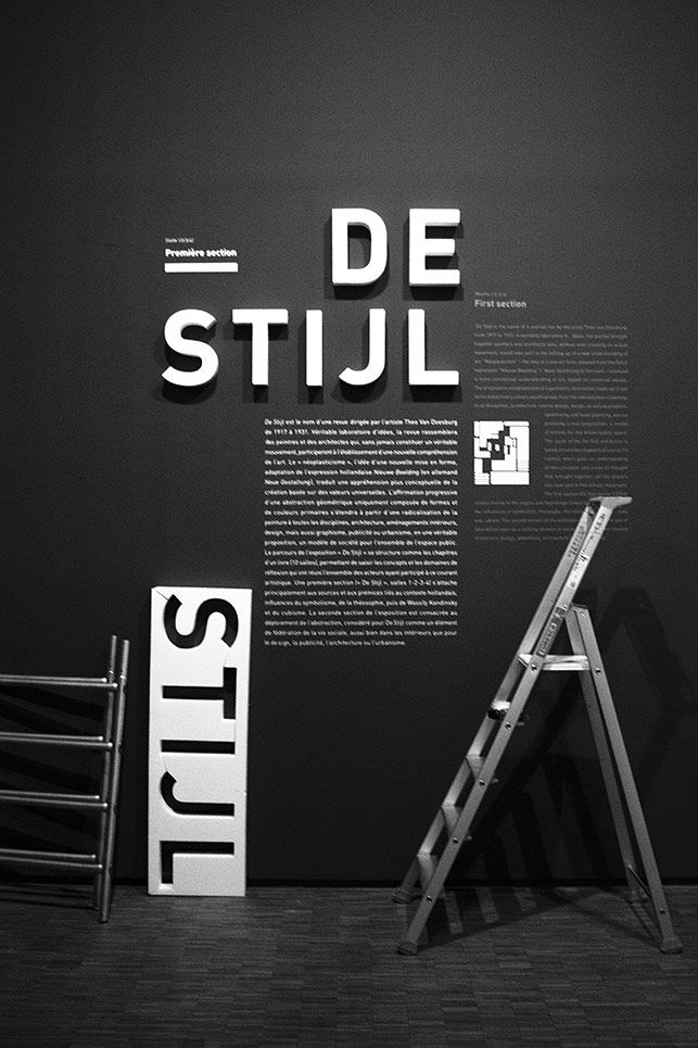 Design and production of signage exposure Mondrian / De-Stijl. Titration extruded white lettering on white that only light make legible between architecture, design and minimal graphics, the program is announced.