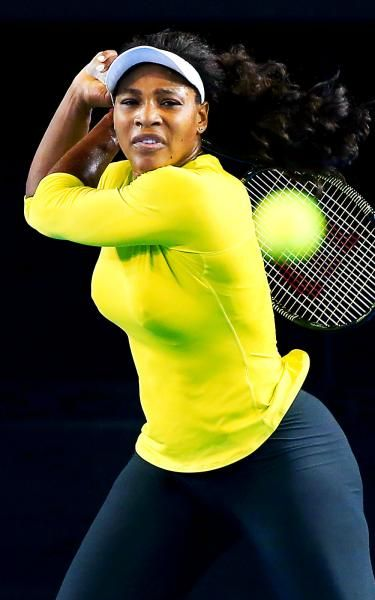 No. 1 Serena Williams strikes some tennis balls on the practice court ahead of the 2015 Australian Open.
