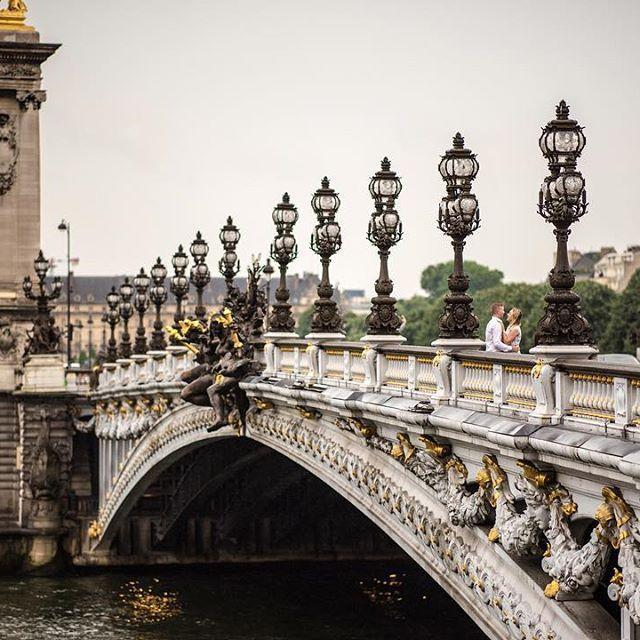 Just a little stroll through the streets of #paris during our #Couplescape shoot. It was a bit rainy so we headed over to the Pont Alexandre III to take advantage of the incredible design Paris' monuments have.  Come join us on our next adventure to Morai
