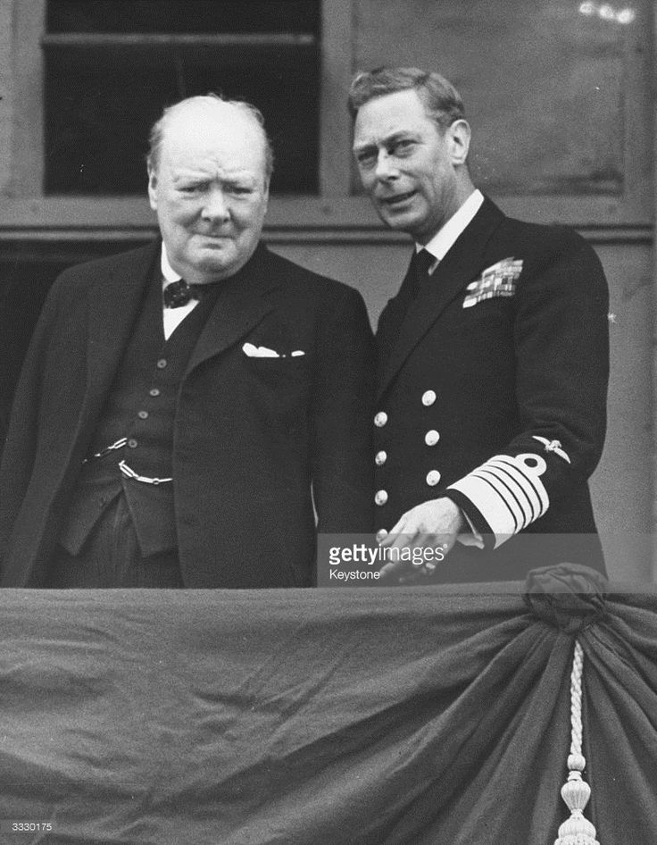 British statesman and prime minister Sir Winston Churchill (left) and King George VI on the balcony of Buckingham Palace, London, on VE Day.