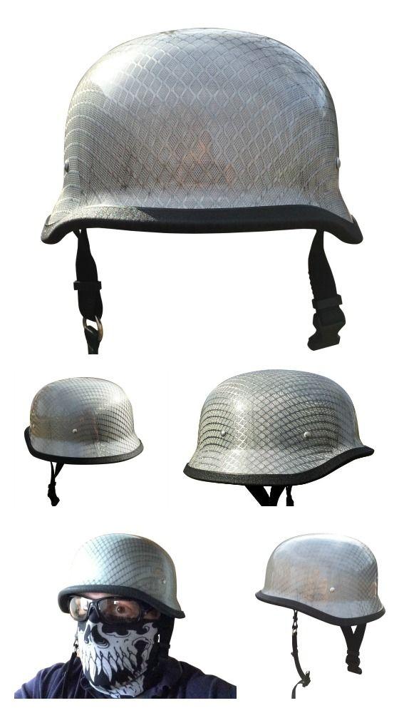 Carbon fiber german motorcycle helmet with chrome mesh weave pattern.
