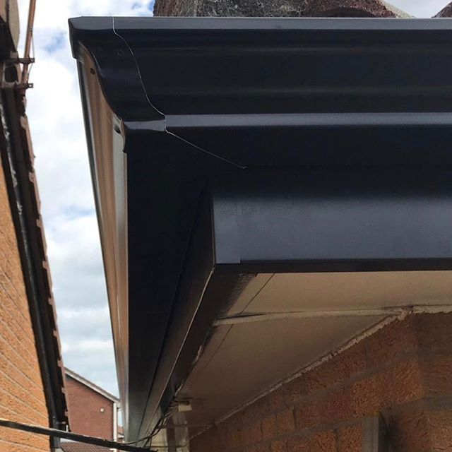 Black Aluminium Guttering And Black Aluminium Fascia Covers Fitted By Bridge Rainwater Solutions Low Maint Seamless Gutters Commercial Roofing Gutter Repair