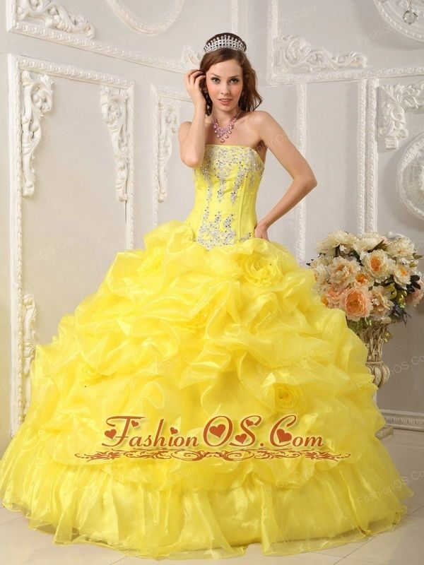 Cute Yellow Quinceanera Dress Strapless Organza Beading Ball Gown  www.fashionos.com    If you wear this quinceanera ball gown , you will be stunning in the dance floor! This lovely dress is made of beaded embroidery appliques bodice with the dropped waist and a puffy skirt is accented with bubble pick-ups organza which adds to its overall fullness! The back features a corset-style closure that ensures a perfect fit. You'll feel like a queen in this strapless dress !