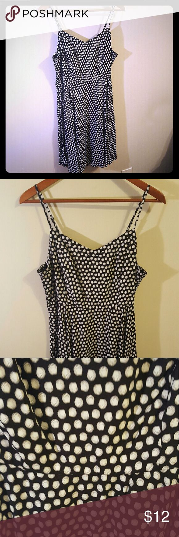 Strappy sundress Black and white strappy sundress. From far away, it looks like white polka dots... up close they are tiny seashells! Adjustable straps, v neck, elastic waist, zip up back. So flattering, a best seller at Old Navy. Never worn... NWT! Size says L Petite... I would still consider it a regular large, unless you are super tall. Old Navy Dresses Mini