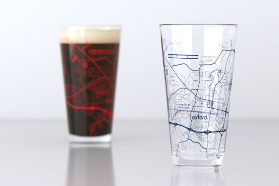 A pair of 16 oz College Town pint glasses featuring a map of the campus, streets and neighborhoods of Oxford, MS - Ole Miss. Printed with crisp detail in the colors of the home team.  The perfect gift for back-to-school, graduations, reunions... or your next college football tailgate!  Looking for a different map or glass type? We have HUNDREDS of maps of your favorite city, college town, island and mountain listed on our Etsy shop here: https://www.etsy.com/shop/theUncom...