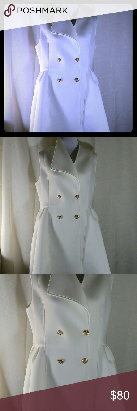 Tuxedo Dress NWOT Tuxedo Dress  Color - Ivory Size - 2XL Approx. Dimensions - front length = 56.5 in, back length (from neck) = 32 in Replacement button included  Elegant Tuxedo style dress that flatters any body type. The dress is adorned with gold buttons, a tuxedo split tail, and a one flap collar. This dress demands attention when you enter the room. This tuxedo dress is great for any occasion; a night out or even a wedding. Dresses