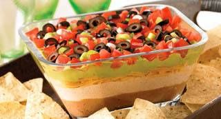 7 Layer Fiesta Dip: Everyone will want to dig into this spicy 7 layer fiesta dip. Bring on the chips.