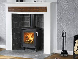The Contura 51L wood burning stove with its low legs looks great in an inset fireplace