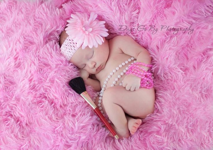 Newborn photography baby girl, without the makeup brush... More necklaces and jewels around!