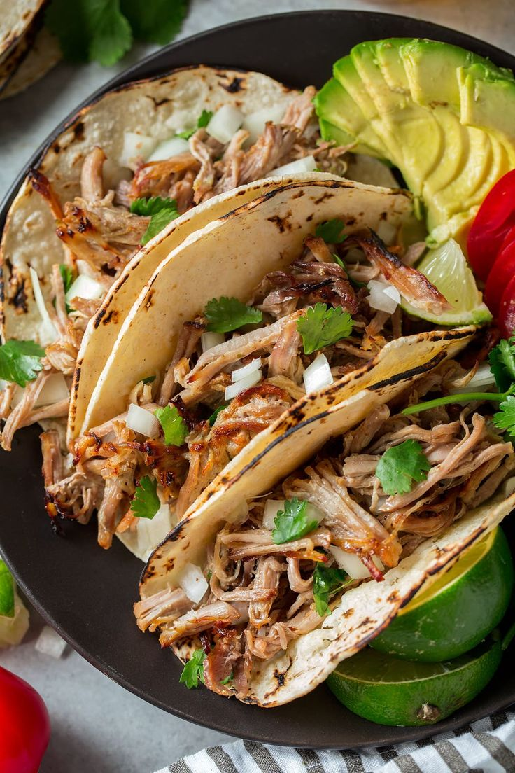 These Instant Pot or Slow Cooker Pork Carnitas are the best! Easily just as good as what you'd find in any Mexican restaurant but you get to enjoy them at a fraction of the price in the comfort of you
