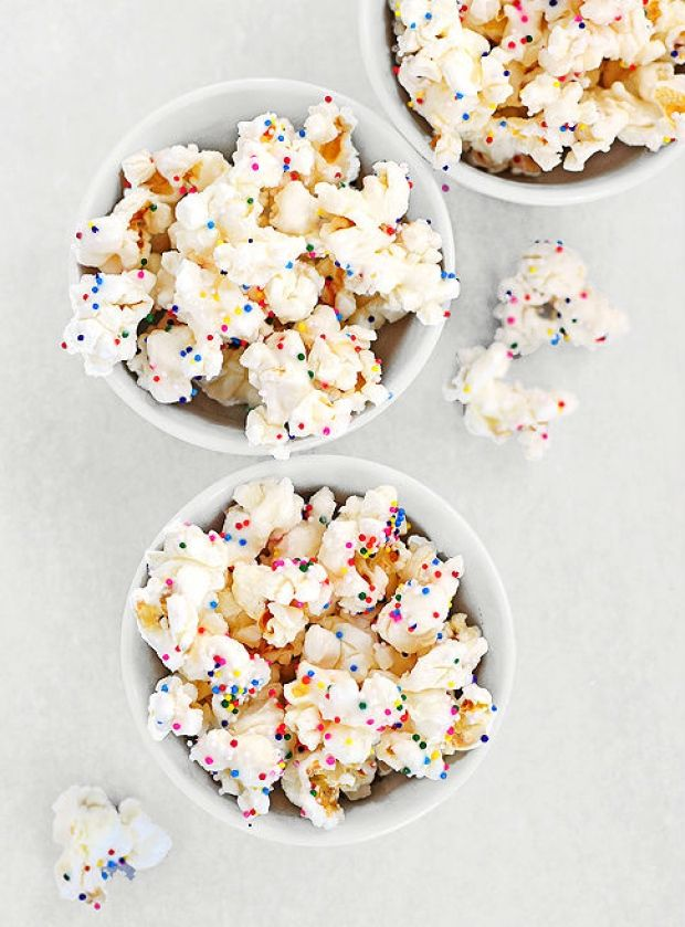 White chocolate confetti popcorn: Popcorn gets a sweet upgrade! Cute party or movie night bites served in pink cones.