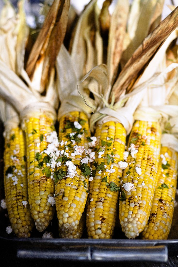Slathered with queso fresco and ancho chili powder—Mexican street-food style—this recipe for corn on the cob is sure to be the hit of your barbecue.