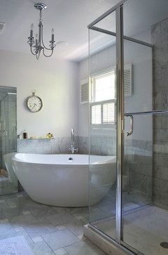 Master bath: placement of tub in the corner seems like a great space saver. I wonder if this is a two person tub.