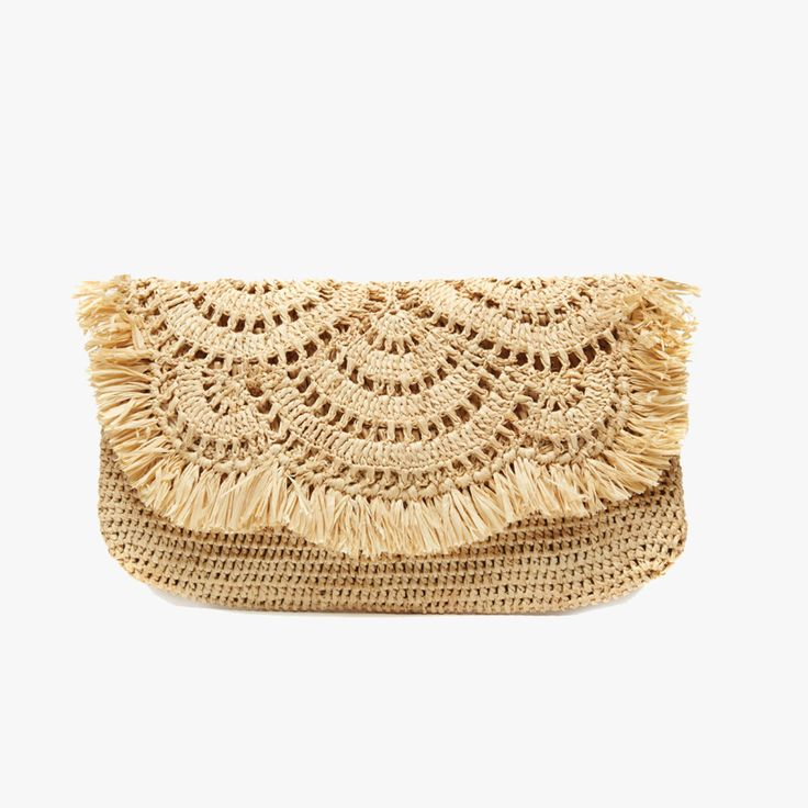 Our Giselle Natural Straw Clutch from Mar Y Sol is accented by festive fringe an…
