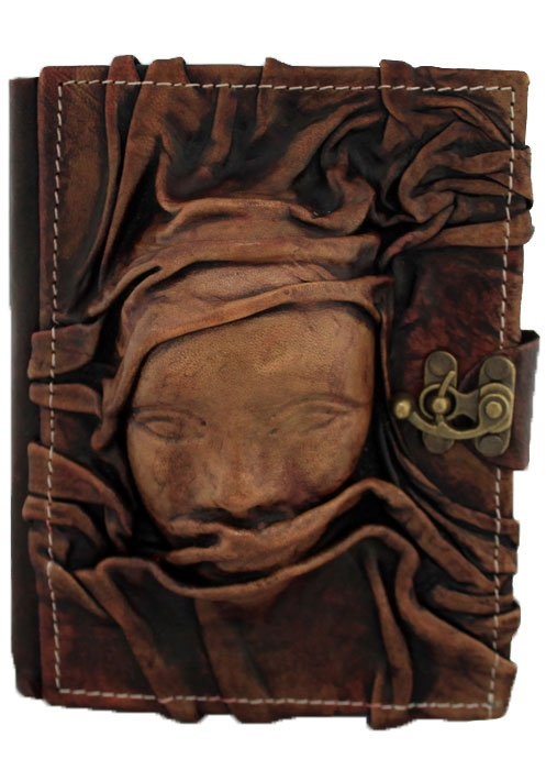Unique handmade leather journal with the head of a Medium sized scarfed womanat the front. This great piece of art is combined with a Journal which can also be used as a notebook.The paper used in the Journal is top quality Persian Paper and can be used for both sketching and writing.