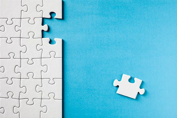 Jigsaw Puzzle on Blue stock photo