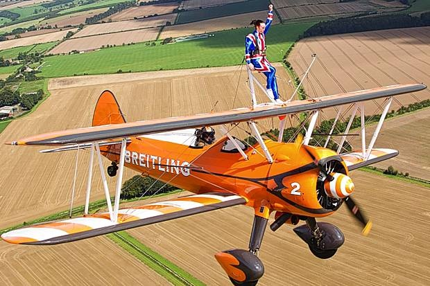 Retired gymnast Beth Tweddle balances on biplane while flying the in a Union Jack jumpsuit - Olympic News - Olympics - Evening Standard