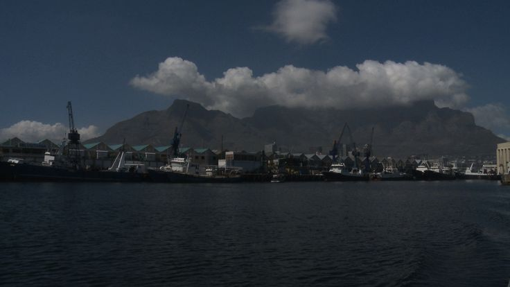 Table Mountain image taken from a boat. See the white cloud forming above the mountain. When the cloud covers Table Mountain it is called the 'Table Cloth'. #capetown #travel #southafrica #tablemountain #mountain #cloud #africa